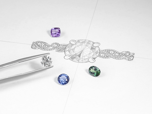 Loose Diamonds and Colored Gems Next To a Sketch of a Ring