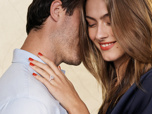 Woman With Hand On Fiance's Shoulder and Engagement Ring On Her Finger