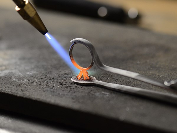 Heating the metal on an engagement ring.