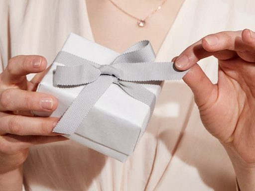Woman opening present.